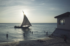 Sunset in Stone Town (Balthus Van Tassel) Tags: africa zanzibar stonetown sunset window dhow sail boat sea beach