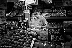 The Price is Right (Bart van Hofwegen) Tags: write writing market vendor fruit price buy sell commerce spain andaluca andalusia malaga mercado mercadoatarazanas mercadocentralatarazanas man street blackandwhite monochrome