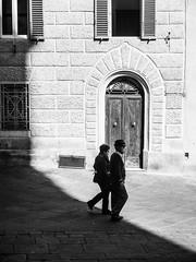 Attraversando (bulgit) Tags: couple passing shadow light door windows bright side edge blackandwhite siena tuscany italy