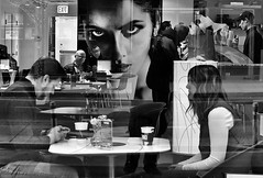 Scene at a Coffeeshop (draketoulouse) Tags: chicago loop street streetphotography people coffee mural blackandwhite monochrome reflection window city urban couple eyecontact candid downtown
