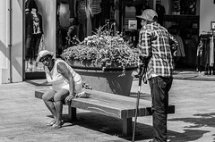 Sitting, Standing, Watching and Waiting (Pauls-Pictures) Tags: street city friends two people urban blackandwhite woman man black men netherlands mall bench photography women couple sitting image candid portait pair streetphotography photograhy almere streetphotos disability streetpics streetphotograhy streetpictures