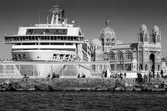 Ship and Cathedral (markangeloharrison) Tags: monochrome contrast docks marseille ship cathedral harbour quay controversy dockingship marseilledocks