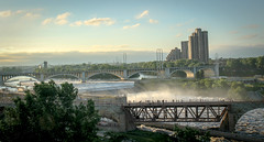 Stone Arch Bridge 2 (Stevesworldofphotos) Tags: city water minnesota river downtown flood dam minneapolis waterfalls mississippiriver lockanddam stonearchbridge
