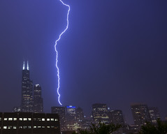 striking the Trump (olsonj) Tags: city chicago tower rain skyline night illinois sears lightning trumptower willis