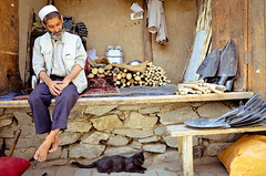 The old man and the cat (tara.m.) Tags: wood afghanistan man cat wise kabul shopkeeper mudhouses shovelstore