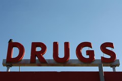 Drugs (Flint Foto Factory) Tags: blue red summer white bird sign bar lasvegas nevada lounge september liquor tavern drugs urbannature signage americana late intersection package 2014 1116 huntridge marylandpkwy echarlestonblvd