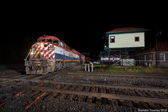 BC Rail in Marion, Ohio (Brandon Townley) Tags: trains railroad bcrail ns norfolksouthern cn canadiannational marion ohio night strobes flash interlockingtower actower ac diamond