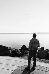 Everyone's dream (lorenzoviolone) Tags: bw blackwhite blackandwhite d5200 dslr monochrome nikon nikond5200 person polaroid665 reflex vsco vscofilm aircrafts airplane clearsky cliff cliffside clouds flying horizon horizonontheland lake sidewalk sky skyline streetphoto streetphotobw streetphotography walk:trevignano=09102016 water trevignanoromano lazio italy