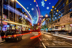"""It's A Kind Of Magic"" Oxford Street, London, UK (davidgutierrez.co.uk) Tags: london photography davidgutierrezphotography city art architecture nikond810 nikon urban travel color night blue photographer uk oxfordstreet cityofwestminster westendoflondon christmas shopping street traffic road centrallondon londonphotographer bluehour twilight buildings england unitedkingdom 伦敦 londyn ロンドン 런던 лондон londres londra europe beautiful cityscape davidgutierrez capital structure britain greatbritain d810 building candid neon iconic lights colourful vibrant streets attraction icon people colors colours colour dusk pedestrian shops xmas nikon2485mmf3545gedvrafsnikkor nikon2485mm streaminglights lighttrails christmaslights taxi cab"