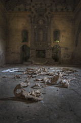 Skeleton bones and holy stones. (Robin Decay) Tags: lachiesaconleossa skeleton bones holy stones church old grave tomb death floor altar pray decay