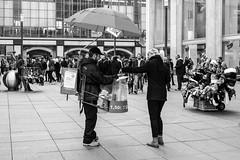 Bratwurst Verkufer (JuliSonne) Tags: streetphotography streetfotografie street berlin alexanderplatz people child teenager passanten schwarzweiss urbanewelt