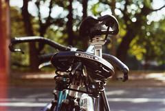 A Bike Named Speedy (_anke_) Tags: zenitet zenit 35mm kleinbild filmphotography film bokeh bike bicycle dof depthoffield autumn fall season seasonal bremen wallanlagen brooks brookssaddle filmburn burn analog analogue 2011 grain grainy