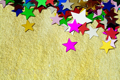 Colorful stars on gold background, close up (PicciaNeri) Tags: glow festivities glitter starshape xmas christmas starnight seasonal festive celebration text birthday aspirations goldstar background black decorative card celebrate sparkle confettistars motif december present goldenconfetti goldconfetti winter gift border color party goldstars gold confetti star dreams goldenstars greetings holidaycard blue colorful holiday blank message ornate metallic decoration closeup goldenstar nobody copyspace happy golden