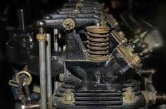 Overhead-valve assembly - Cirrus Mk.II air-cooled aero-engine, 80-hp, 1925 - Science Museum, London (edk7) Tags: nikond300 edk7 2013 uk england london royalboroughofkensingtonandchelsea southkensington sciencemuseum cirrusaeroenginesltd cirrusmkii aircooled overheadvalve vertical inline 80hp 1925 aircraft aviation engine motor metal tube fourcylinder nut bolt fin rocker pushrod