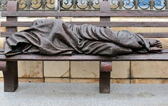 """Homeless Jesus"" sculpture at the entrance to the Cathedral of Madrid (robin denton) Tags: sculpture statue madrid spain cathedralcity cathedral jesus bench bronze homelessjesus timothyschmalz figure homeless"