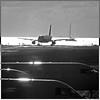 Sint Maarten Airport - Caribbean Sea (pom.angers) Tags: panasonicdmctz3 2010 sintmaarten caribbeansea netherlands europeanunion february plane airport monochrome saintmartin fromamovingvehicle 100 atlanticocean