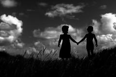 Wish (Ans van de Sluis) Tags: portrait children girl boy bw mono monochrome blackwhite blackandwhite clouds sky surreal art fineart ansvandesluis wish together handinhand shouldertoshoulder