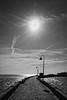 Camino del Sol (Javier Martinez de la Ossa) Tags: sunset blackandwhite bw españa blancoynegro sol contraluz andalucía spain agua nikon bn cádiz farolas espagne atlántico backlighting caleta océano d700 nikond700 bahiadecádiz javiermartinezdelaossa