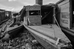 Unused (FleetingEye) Tags: street city travel blackandwhite bw building peru southamerica water boats amazon cityscape scenic international shack iquitos streetscape 2012