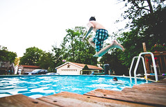 Jumping in the pool (doug_so_fresh) Tags: pool daylight kid wideangle summertime canon7d tokina1116mmf28