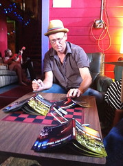 Tim Nielsen, autographing 'Scarred But Smarter: Life N Times Of Drivin N Cryin' DVDs
