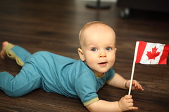Phil with the Canadian Flag (bukharov) Tags: boy baby holding 912 floor blueeyes months canadianflag lying russian caucasian
