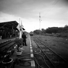 The Train is Coming! (fuadabd) Tags: travel vacation holiday mediumformat thailand ishootfilm railways kodaktmax400 kanchanaburi trainride amazingthailand shootingfilm holgagn filmnotdead blackandwhitefilmphotography bwfp