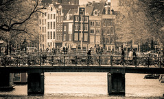 Amsterdam Keizersgracht (Michael Shoop) Tags: street travel bridge people blackandwhite bw holland tourism water amsterdam bike canon canal europe candid nederland nl europeanunion keizersgracht bicyle noordholland canalhouses michaelshoop