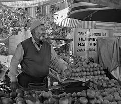 Turkish market seller (Marian Pollock - Thanks for a million+ views) Tags: people sign umbrella turkey market stall apples cartons selling