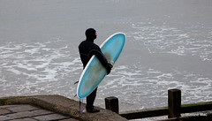 Surfing contlempation (mootzie) Tags: aquaaberdeen blue surfboard wetsuit sea groynes surfer fins leash