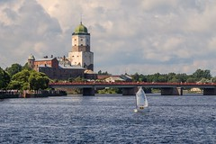 VYBORG, RUSSIA View of the medieval  castle from the side  the Gulf (mikhafff1984) Tags: ancient architecture area bay castle city clouds cloudy day defense fortress landmark landscape leningrad medieval olaf region russia saint sky stronghold summer surface tower view vyborg water
