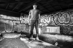 trap doors to endless wisdom (Super G) Tags: nikon293 selfportrait bw blackandwhite abandoned concrete building pit trap standing hat jeans urbex graffiti spc