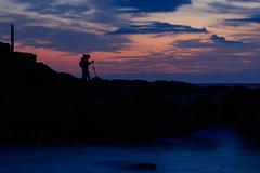 Photographer on the rock (t.kunikuni) Tags:        jp        japan ibaraki ibarakiken oarai oaraimachi oaraicoast oaraiisomaejinjashrine sunrise daybreak dawn coast sea ocean shrine torii