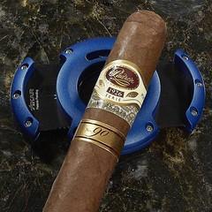 Cigar and accessory of the day. The new #Xikar XO Circle cutter and the #Padron 1926 90th Anniversary #cigar. #cigaroftheday #cigarlifestyle #cigars #cigarart #cigarsnob #cigaraficionado #cigarporn #nowsmoking #smokingcigars #luxurycigars Thecigarphotogra (thecigarphotographer) Tags: ifttt instagram cigars