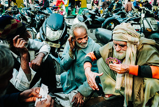 Elders playing cards on busy New Delhi street