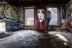 explaining the election results to the mona lisa (Super G) Tags: nikon293 selfportrait abandoned graffiti monalisa urbanexploring twopeopleapproachedthisplaceasiwasinsideandiscaredtheshitoutofthembecausetheydidntthinkanyonewouldbeinside