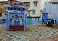 town square patterns (SM Tham) Tags: africa morocco chefchaouen thebluecity thebluepearl placeelhaouta townsquare plaza piazza fountain watersource patterns paving buildings houses streetscene people outdoors