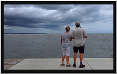 Looking on.. (agphoto100) Tags: yacht sailing olympus sz16 photoshop sandgate brisbane queensland beach water sea boat mast waves concrete people walk clouds sky rough