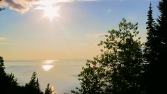 Lake Superior Sunset (Sam Wagner Photography) Tags: ocean blue trees sunset orange cliff sun lake beach set clouds timelapse video long exposure waves time stock lapse footage