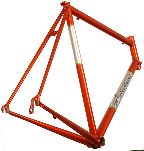 <p>Rear view of Waterford 33-Series Race Ready in Orange Glow over Sterling SIlver with Silver Panels and Waterford's world Championship color bands.</p>