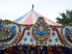 Merry Go Round Detail (trumpeterny) Tags: carnival flowers light flower festival lights amusement scenery ride jester clown carousel fair canvas joker rides canopy merrygoro