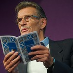 William McIlvanney reading on stage a the Edinburgh International Book Festival