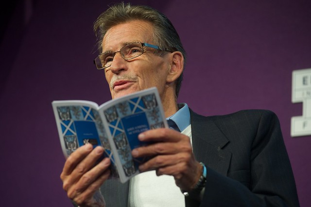 William McIlvanney reading on stage a the Edinburgh International Book Festival
