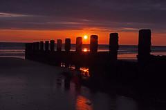 July Sunsets 6 (John Ibbotson (catching up!)) Tags: sunset sea sun beach silhouette clouds coast seaside