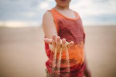 Like sands through the hourglass (demandaj) Tags: boy orange texture kid sand hands play desert fingers explore learn