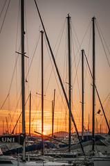 Alghero (ambrogio_mura) Tags: sunset sea hot color 35mm harbor boat holidays tramonto mare harbour yacht dream barche porto f18 settembre alghero alguer d90
