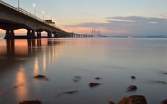 Vanishing rocks (amy_woolnough) Tags: bridge blue sunset reflection beach river bristol lights high twilight nikon rocks colours crossing motorway dusk pastel tide estuary severn hour second hazy tidal m4 d3200