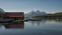 Maligne Lake Boathouse (dbushue) Tags: lake canada mountains nature reflections landscape boats dock nikon jasper canoes alberta boathouse jaspernationalpark malignelake canadianrockies 2014 coth absolutelystunningscapes damniwishidtakenthat coth5 dailynaturetnc14