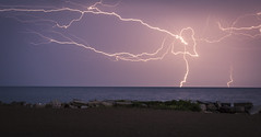 light show (olsonj) Tags: morning light beach water night sand rocks bright boom lightning lakemichgan crakling
