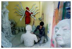 A workshop at Kumartuli, Kolkata | 2016 (b i s w a j i t) Tags: kumartuli durga puja 2016 kolkata manatwork artist sculture idolmaking workshop colors red saree